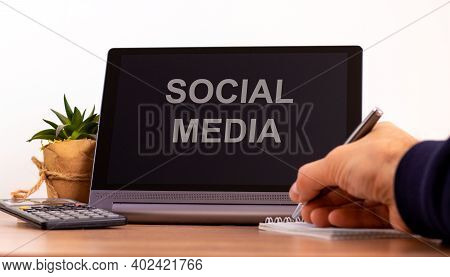 Social Media Symbol. Tablet With Words 'social Media'. Male Hand With Pen, Calculator, Copy Space. B