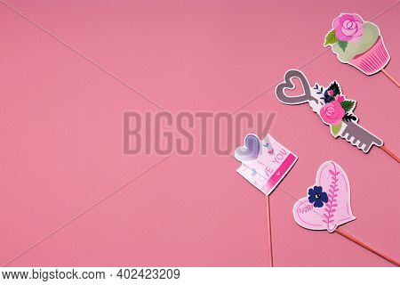 Party Accessories On A Pink Background. Postcard Concept For Valentines, Womens Day, Mothers Day, Bi