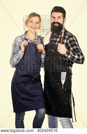 Tools For Roasting Meat. Couple In Love Hold Kitchen Utensils. Man Bearded Hipster And Girl. Prepara
