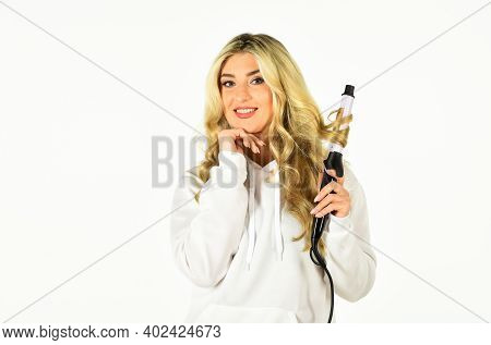 Create Beautiful Hairstyle With Curling Iron. Hairdresser Tips.woman With Long Curly Hair Use Curlin