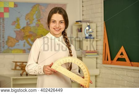 High School Student Learning Geometry In Class. Measure Angles In Degrees. Small Child Girl Holding