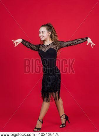 Happy Teen Girl Ballroom Dancer. Childhood Happiness. Dancing School. Child Dancing In Black Dress.