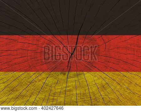 German Flag On Wooden Surface. German Flag On Textured Background. National Flag Of Germany