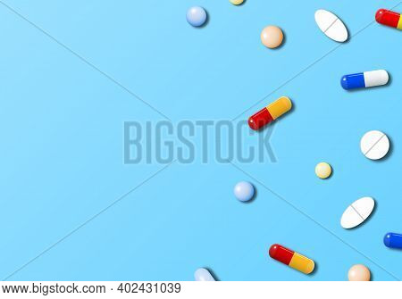 Realistic Medicines On Light Blue Background With Copy Space.