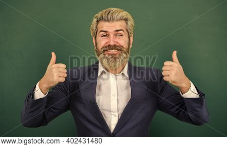 Super Teacher. Happy Man Give Thumbs Ups At Chalkboard. Senior Professor Smile Gesturing Thumbs Ups.