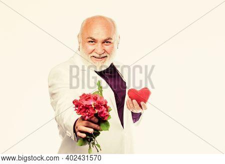 This Is For You. Senior Gentleman Romantic. Man Hold Heart Symbol Of Love. Gentleman Concept. True G