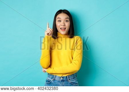 Excited Asian Woman With Short Dark Hair, Pitching An Idea, Raising Finger In Eureka Gesture And Smi