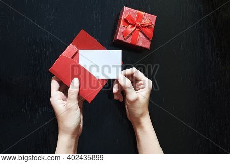 A Girl Puts In An Envelope Her Love Message. Closeup Image Of Woman Puts It In An Envelope Letter Wi