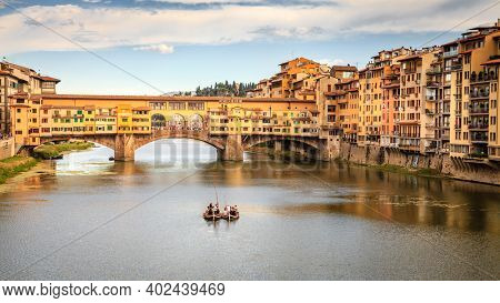 Florence, Italy, September 20, 2015: View of the Ponte Vecchio (Old Bridge) and gondolas in Florence, Italy