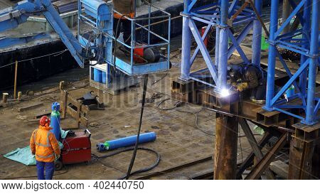 Warsaw Poland 22.01.2019 Work In Progress Of Construction Workers Welding Metal Of A Column Structur