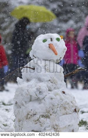 Madrid, Spain - January 08, 2021: Children Playing With Snow And Making Snowmen, In The Buen Retiro
