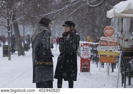 Madrid, Spain - January 08, 2021: Couple Of Girls Enjoying A Walk Through The Buen Retiro Park In Ma