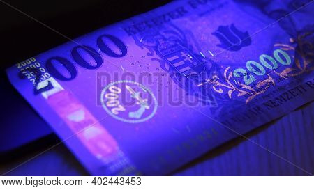 Warsaw, Poland 01.01.2021 2000 Hungarian Forint Banknote Being Tested For Counterfeiting Under The U