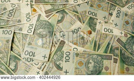 Warsaw, Poland 01.01.2021 Polish Zloty Banknote Bundle. 100 Pln Money Stacks. Concept Of Crisis, Ban