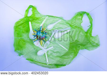 Plastic Products, Such As Plastic Bags, White And Clear Plastic Spoons, Were Placed On White Backgro