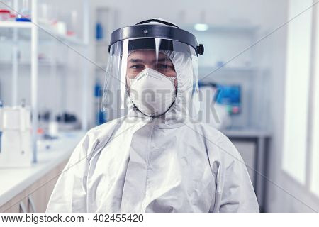 Biochemistry Scientist Wearing Face Mask And Face Shield As Safety Precaution For Covid19 Outbreak W