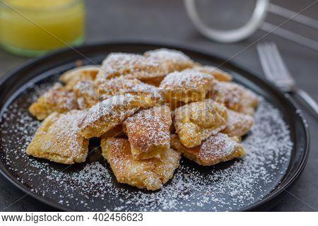 Austrian Cuisine. Torn Pancake (or Omelet) Kaiserschmarrn With Honey, Powdered Sugar