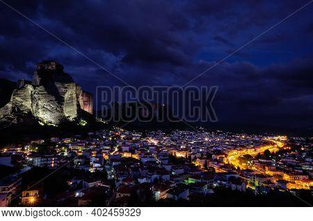 Night View Of Kalambaka And Kastraki Village At Foot Of High Cliffs And Rocks Of Meteora Valley. Gre
