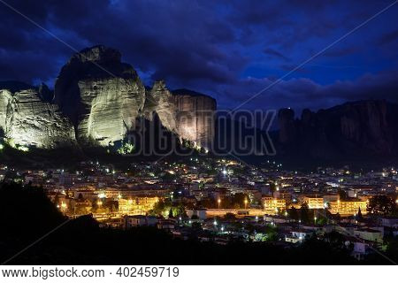 Beautiful Night View Of Kastraki Village At Foot Of Lit Up Massive Cliffs And Impressive Pillars Of