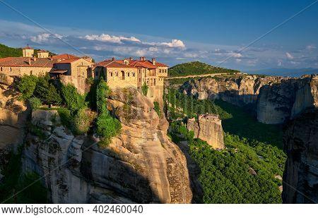 Cliff Top Varlaam Monastery, Evening Sun, Meteora, Greece, Typical Landscape Of Rocks. Moni Agias Va