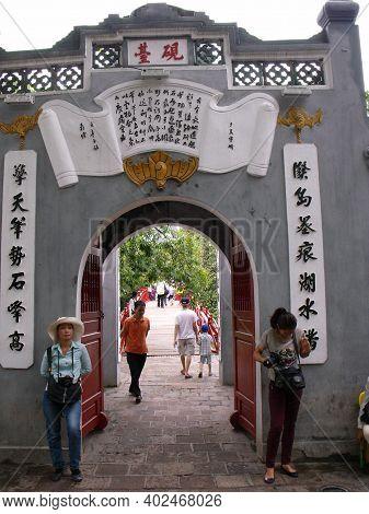 Hanoi, Vietnam, June 16, 2016: Tourists At The Entrance Gate To Ngoc Son Temple. Hanoi