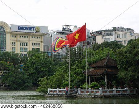 Hanoi, Vietnam, June 16, 2016: Flags On The Shore Of Hoan Kiem Lake In Hanoi