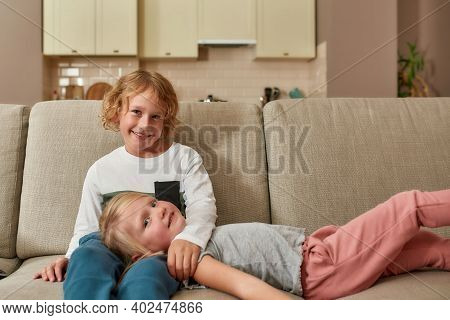 Portrait Of Cute Little Children, Boy And Girl Smiling At Camera While Spending Time Together, Cuddl