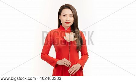 Attractive Young Woman Wear Ao Dai Red Dress With  Lotus Flower On White Background