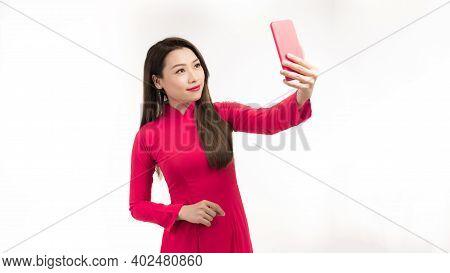 A Beautiful Girls Wear Vietnamese Traditional Dress Ao Dai  Taking Selfie Photo