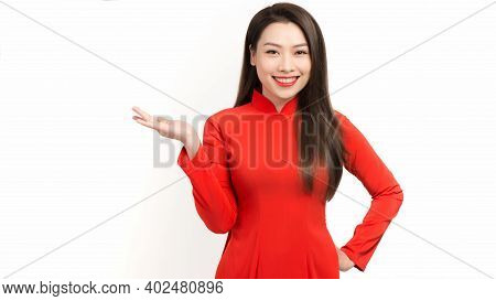 Young Asian Woman In Red Ao Dai With Gesture In Lunar New Year
