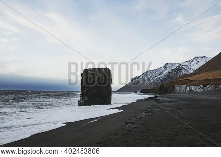 Panorama Of Laekjavik Beach Rock Formation Sea Stack Black Sand Atlantic Ocean Coast Tower East Fjor