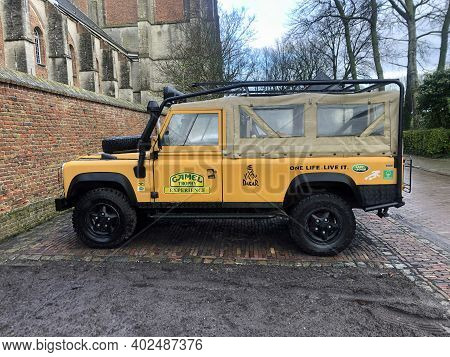 Veere, The Netherlands - Januari 2, 2021: Yellow Land Rover Parked On A Public Parking Lot. Nobody I