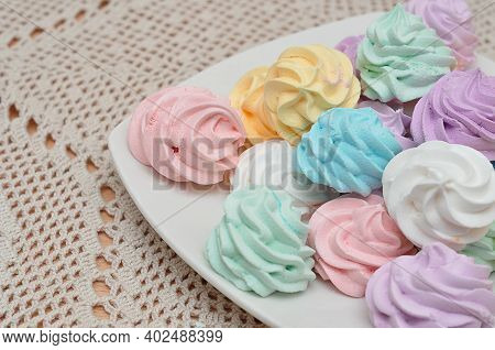 Close Up Of A Plate With Pastel Colored Meringues