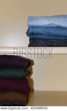 Order In A Closet. Clothes Folded One By One In A Wardrobe, Fall-spring Season. A Basic Wardrobe, Cl