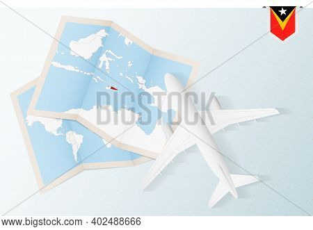 Travel To East Timor, Top View Airplane With Map And Flag Of East Timor. Travel And Tourism Banner D