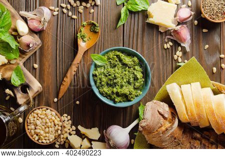Flat Lay View At Food Background With Genovese Pesto Sauce And Its Ingredients On Wooden Kitchen Tab