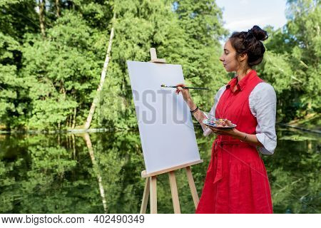 Free Space For Slogan Text, Woman Artist Summer Park Near Lake, River Pond, Draws A Picture, White C