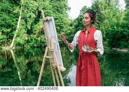 Green Trees, Woman Artist In Summer In Park Lake, River Pond, Draws Picture. Creation Of Creativity,