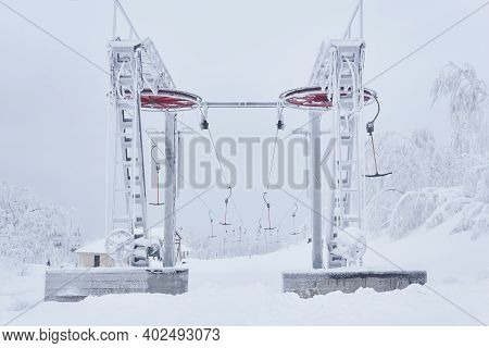 Upper Station Of The Ski Lift On A Snow-covered Hilltop Among Frosty Trees