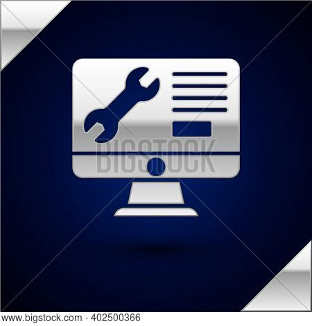 Silver Computer Monitor With Wrench Icon Isolated On Dark Blue Background. Adjusting, Service, Setti