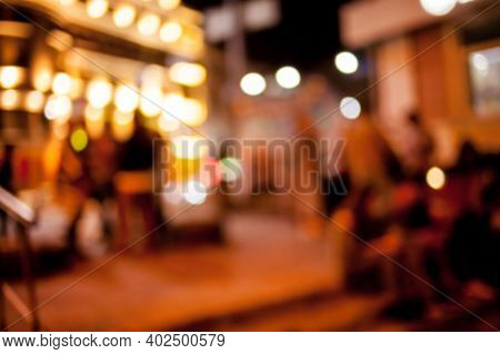 People Rest In An Ethnic , Mexican Restaurant. Blurred Photo. Blur Photo Of Restaurant With Long Tab
