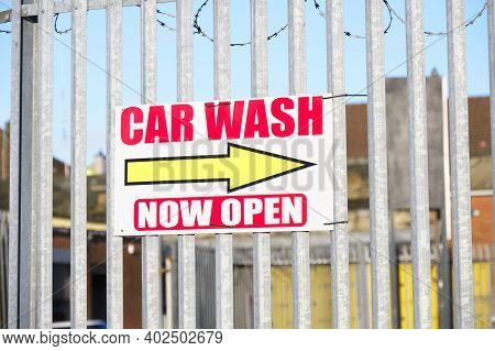 Car Wash Now Open Direction Sign On Fence