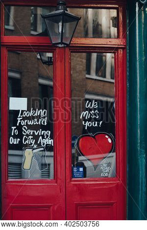 London, Uk - November 19, 2020: We Miss You Heart Signs On A Door Of A Closed The Rising Sun Pub In