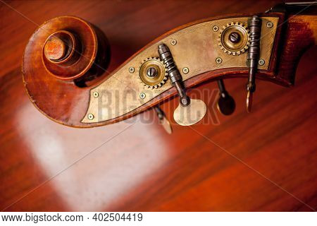 Violin On Wooden Background. Violin And Bow On A Dark Wooden Table. Violin In Vintage Style On Wood