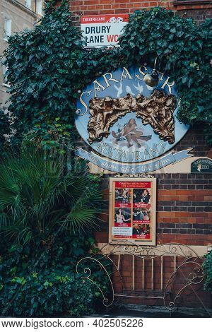 London, Uk - November 19, 2020: Sarastro Restaurant Sign Under The Street Name Sign On Drury Lane. I