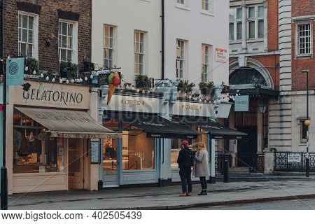 London, Uk - November 19, 2020: Couple Looking At The Window Display Of Oree Cafe In Covent Garden,