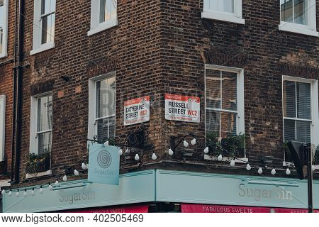 London, Uk - November 19, 2020: Street Name Signs On The Corner Of Catherine Street And Russell Stre