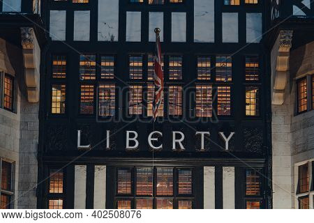 London, Uk - November 19, 2020: Sign And Union Jack Flag Above The Entrance Of Liberty Department St