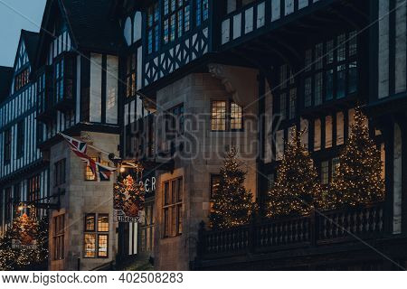 London, Uk - November 19, 2020: Christmas Trees On The Facade Of Liberty Department Store. Opened In