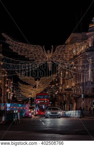 London, Uk - November 19, 2020: Angel Christmas Lights In Piccadilly Circus, One Of The Most Popular